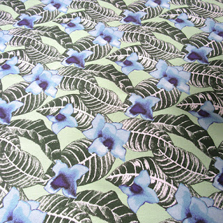 https://www.spoonflower.com/fabric/7038439-tropical-flower-palm-leaf-design-on-green-by-paisleypower