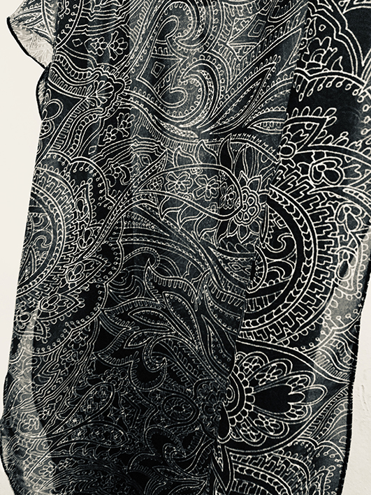 A paisley printed fabric was needed for the linings of jackets worn by life-size wax figures of the pop legend Prince. Patrick Moriarty made a purple version of one of his popular paisley designs specially for the project.