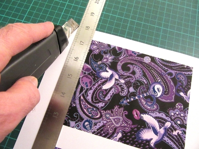 cutting-paper-to-make-card-for-Prince-fans