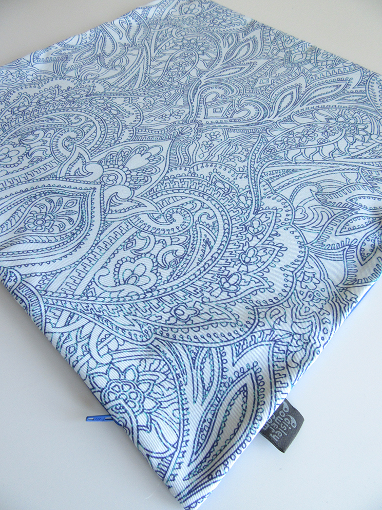 Paisley Power cushion cover with mirrored symmetrical blue linear design on a white background.