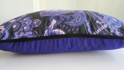 Prince-theme cushion with black piping. Part of the Paisley Power collection of home-ware.
