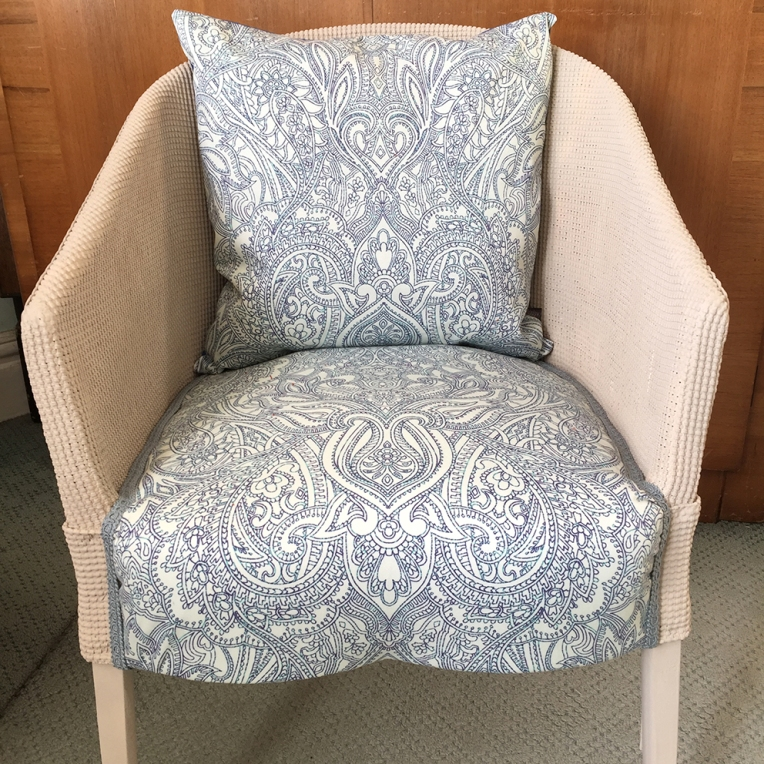 Genuine Lloyd Loom chair reupholstered with Paisley Power symmetrical design fabric.