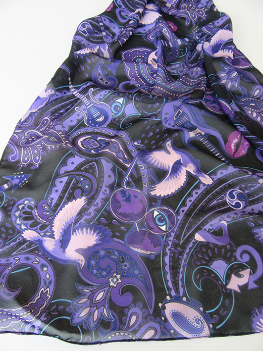 """crying doves and guitars adorn this Prince music themed scarf. Prince's songs called """"Tambourine"""", """"Paisley Park"""", """"Sign O the Times"""" and """"Kiss"""" are also represented in the design."""