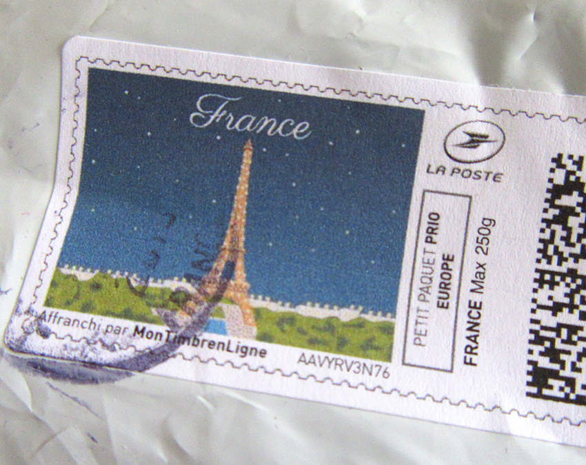 French postage stamp that was used to send fabric to Patrick Moriarty in UK from Toulouse in France. The stamp has an image of the Eiffel Tower in Paris.