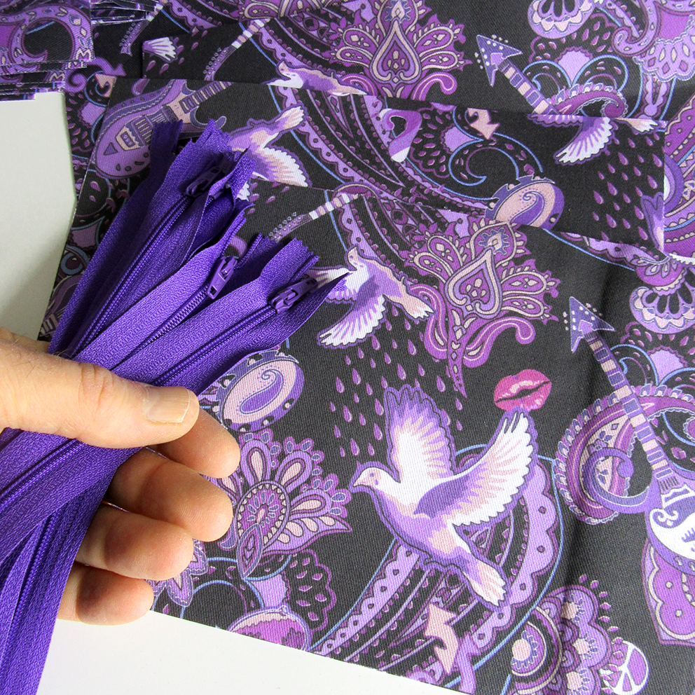 Paisley Prince Songbook fabric with matching purple zips to make makeup bags for a customer in Minneapolis.