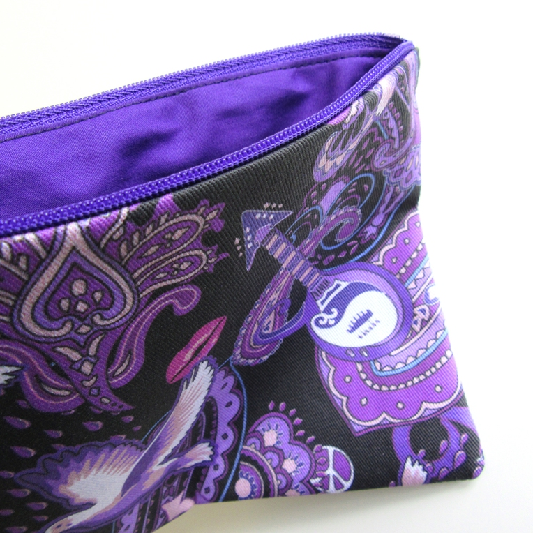purple cotton lining is sewn inside the Prince Rogers Nelson theme bag.