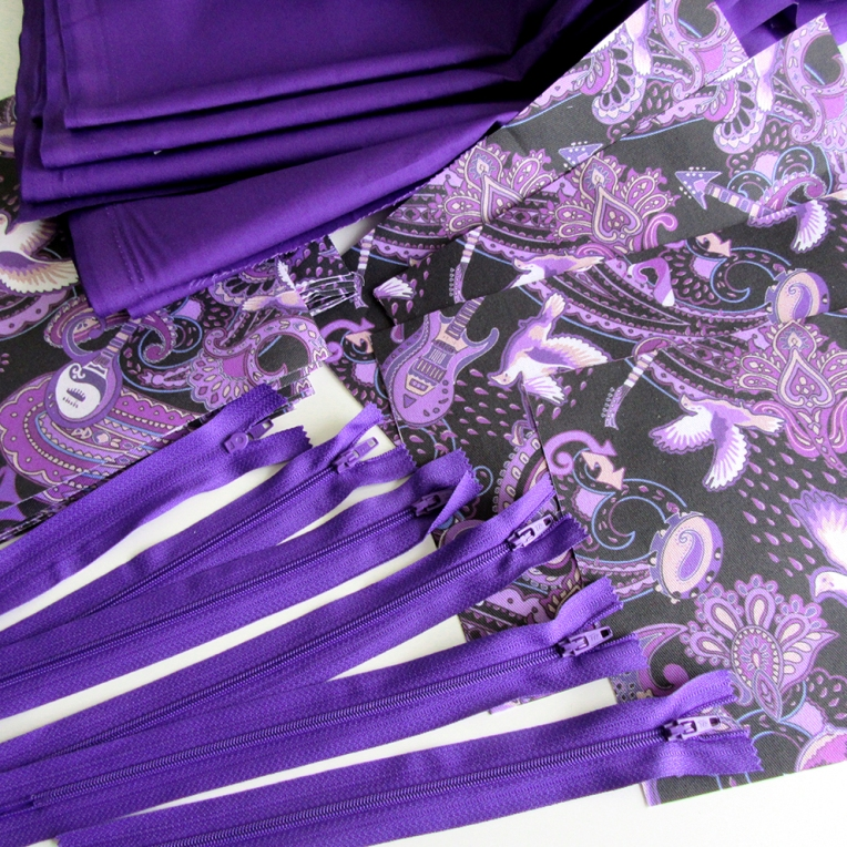 Purple cotton and zips which will be sewn together with the Prince fabric to make makeup bags.