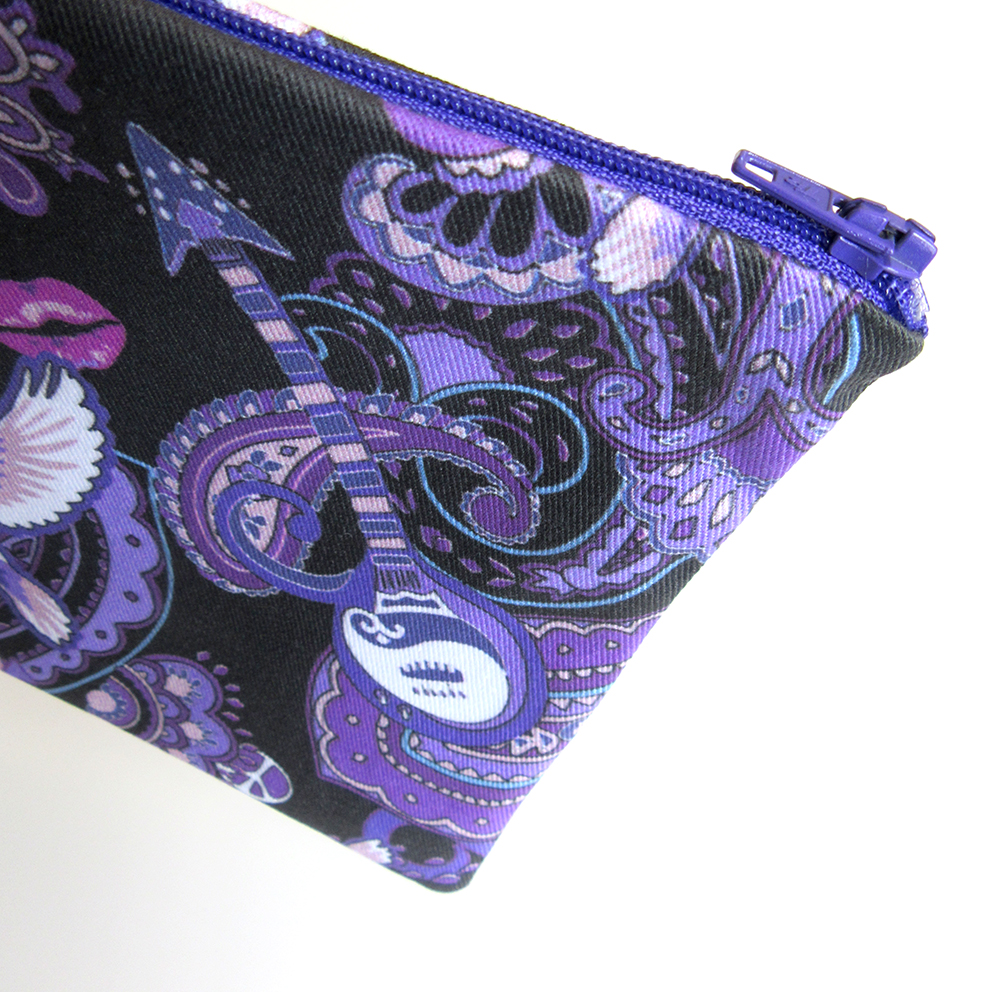 A purple zip is an essential component of the Prince theme bag made in Southend Essex UK. The strong secure zip ensures that everything contained in the bag is safe and secure.