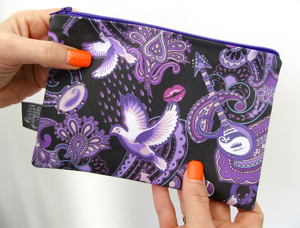 Hand-made Prince-theme zip bag being held by model Philippa Lee. The zip bags were designed by Patrick Moriarty, who was inspired by the songs of Prince Rogers Nelson