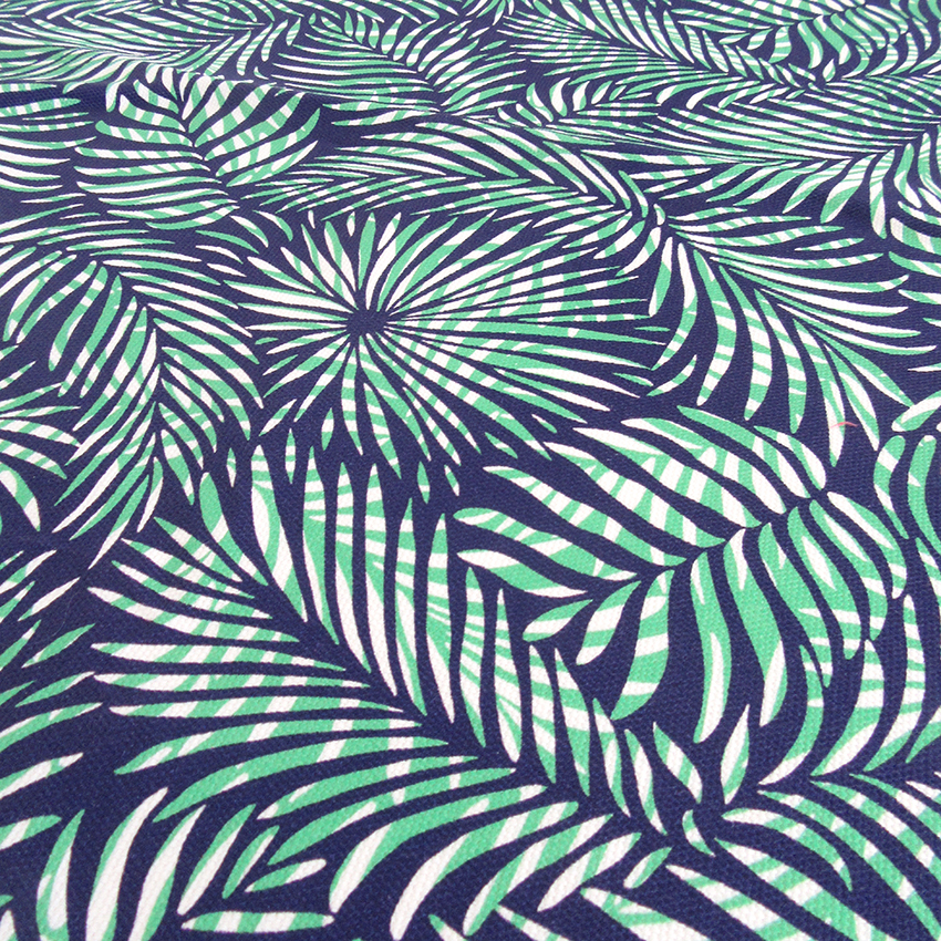 green, blue and white version of the Palm Leaves fabric designed by Patrick Moriarty in Southend-on-Sea, UK