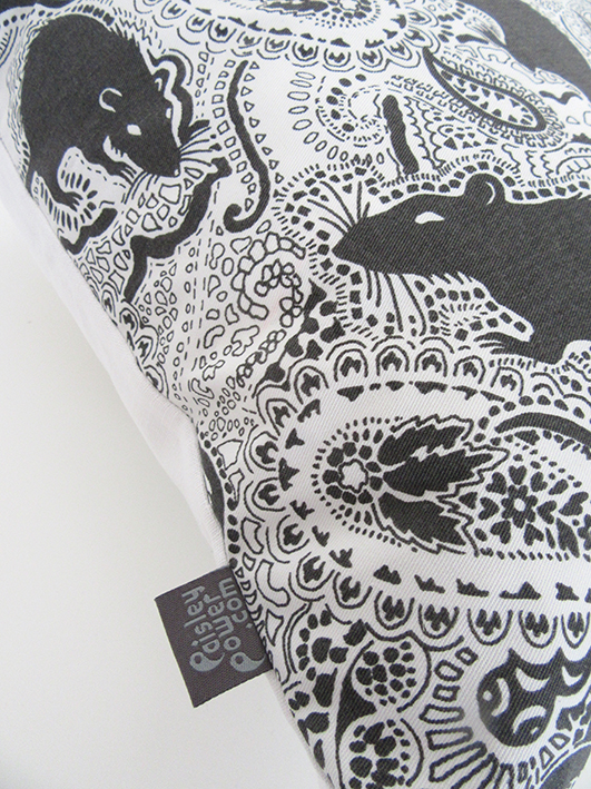 white and black cushion (called a 'pillow' in US). Genuine Paisley Power product.