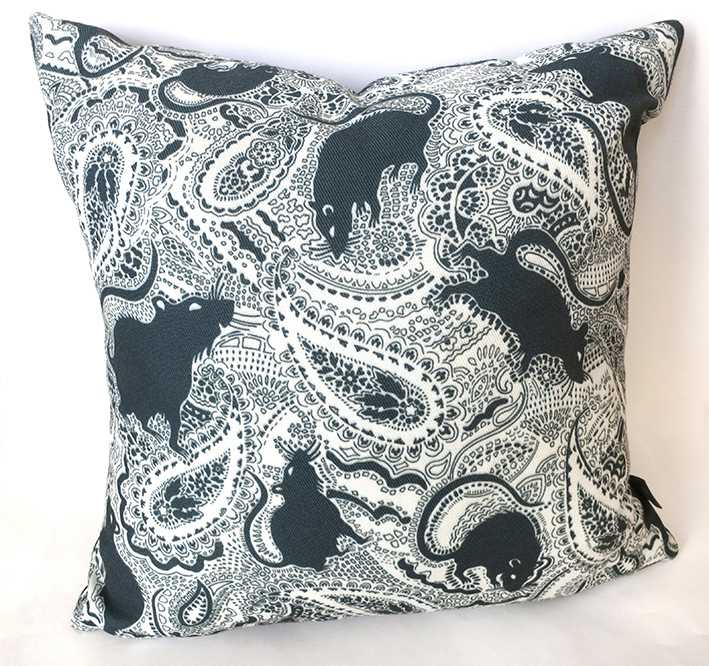 black rat patterned cushion designed by Patrick Moriarty. Paisley symbols are also in the design