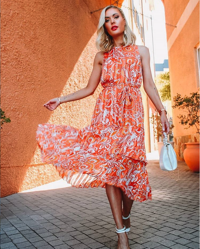 The dress has a light floaty style, which makes it perfect for warm summer days. The pink, orange and white paisley pattern is bright and refreshing. Designer Patrick Moriarty designed the unique paisley pattern.