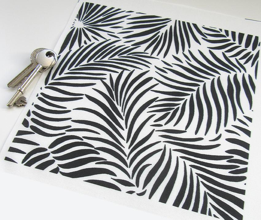"white and black ""palm leaf"" printed textile design."