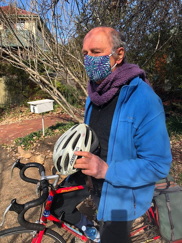 Gerry Jacobson wearing the Palm Leaves (navy blue and green version) face mask when he is cycling