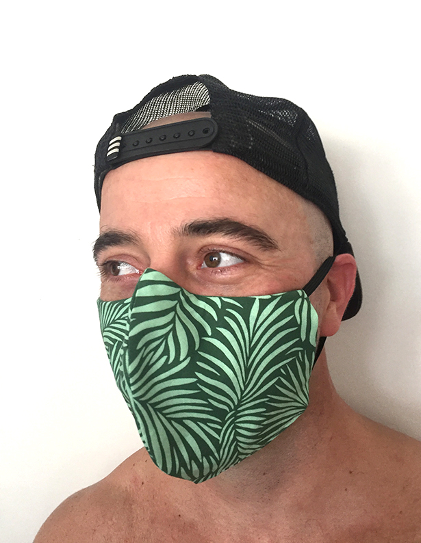 Popular Palm Leaves face mask (green version) modeled by a cool guy
