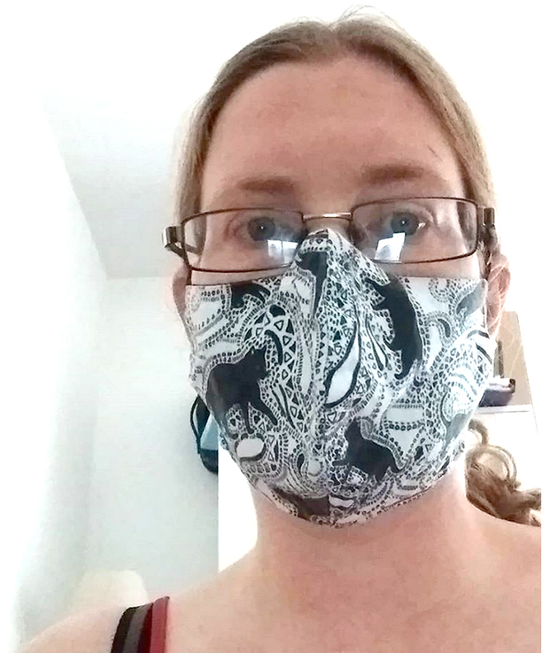 "Hayley in East London wearing a ""Paisley Cats"" face mask"