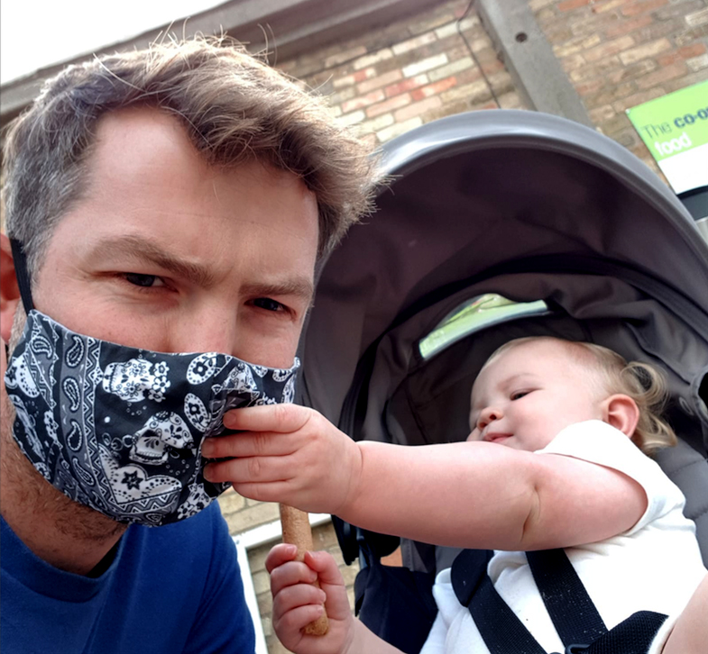 My eldest nephew Ivan with his baby girl, called Olive. Ivan is wearing the Mexican Skulls face mask (black version).