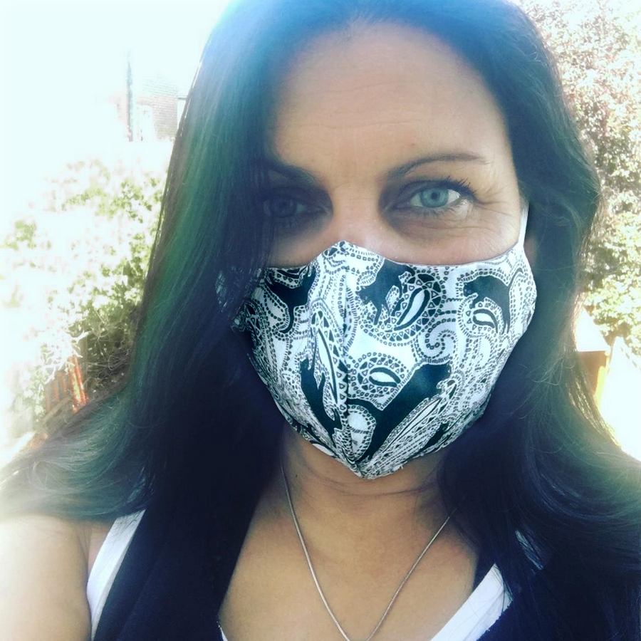 "Yoga instructor Michelle Bappo is wearing a ""paisley cats"" face mask designed by Patrick Moriarty"