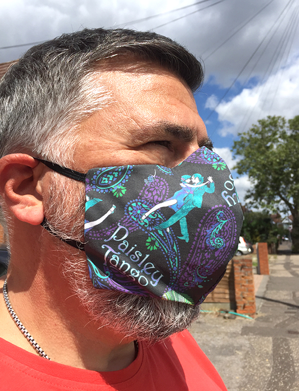 peter wears paisley tango face mask. This is the peacock color version