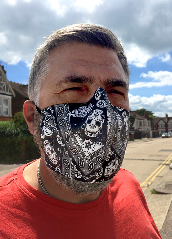 Peter Foxall wearing mexican skulls (black) face mask designed by Patrick Moriarty