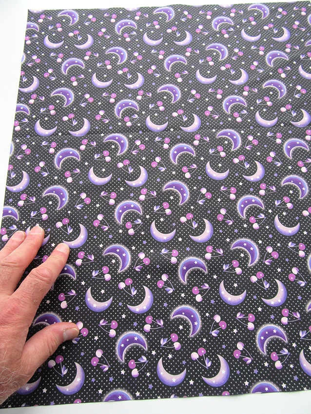 small-scale black version of the cherry moon printed fabric. designed by Patrick Moriarty in 2020