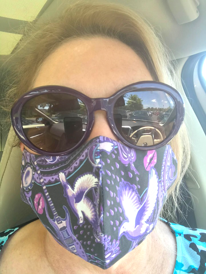 Tina Foster in Tennessee wearing a Paisley Prince Songbook face mask