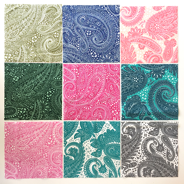 9 different color versions of the Paisley Positivity design printed on cotton