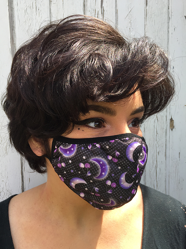 cherry moon facemask worn by model.