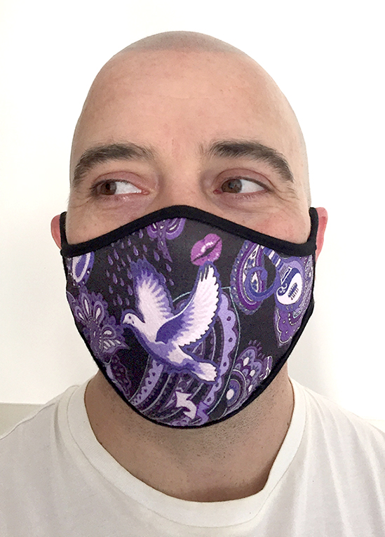 man wearing Prince-themed sports face mask