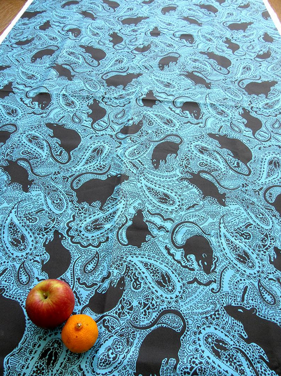 paisley rats turquoise and black fabric designed by patrick moriarty