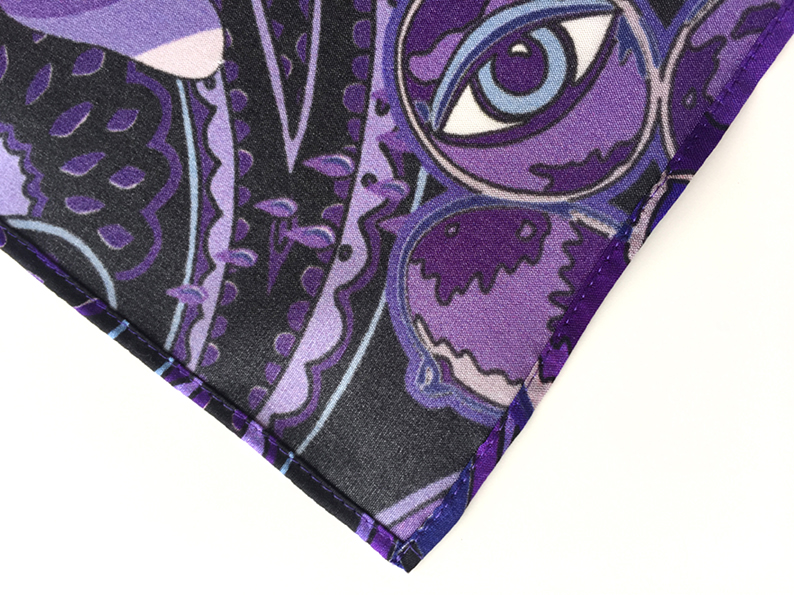 very neatly sewn hem at the edges of the Prince-themed scarf