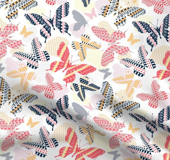 Butterfly design in pink, red and yellow with urban architecture graphics. The design was created by Patrick Moriarty for his brand Paisleypower.