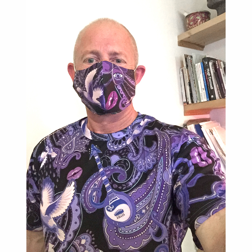 designer Patrick Moriarty wearing one of the Paisley Prince Songbook t-shirts and a matching face mask.