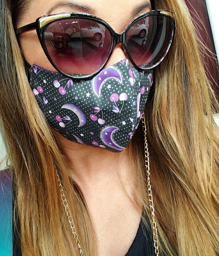 kimberly ryborz wearing a cherry moon face mask in los angeles, US