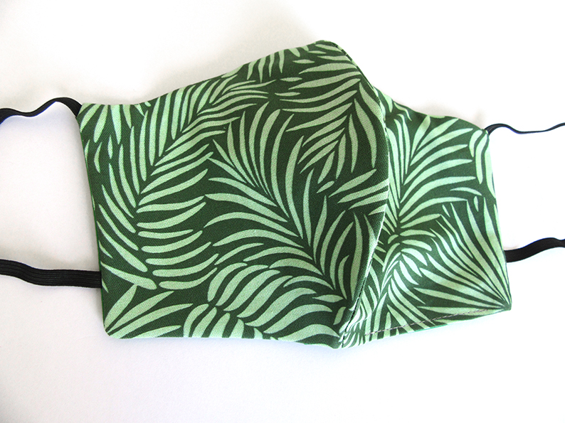 Green Palm Leaves face mask designed by patrick moriarty.