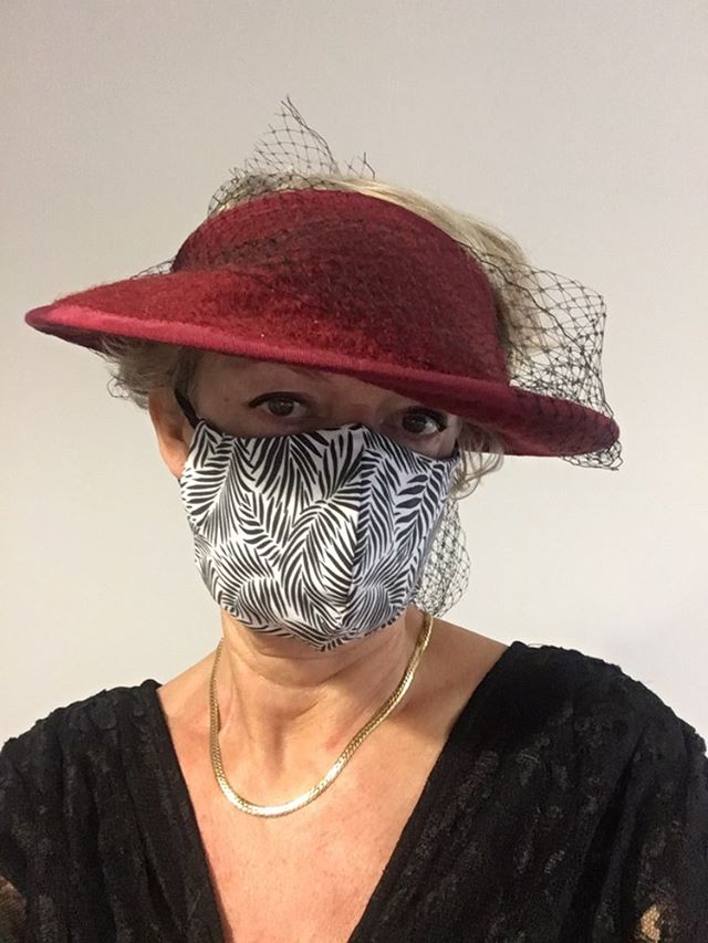 journalist Ros Weaver is modeling a Palm Leaves face mask (white and black version) designed by Patrick Moriarty