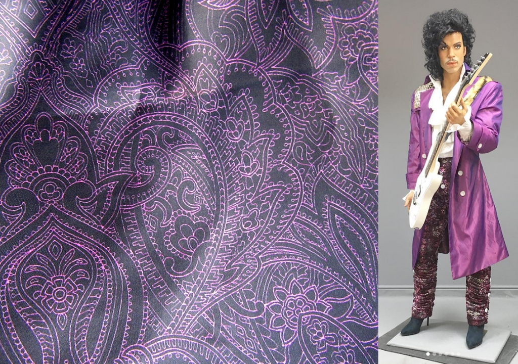 purple-paisley-prince-printed-fabric and wax figure of Prince.